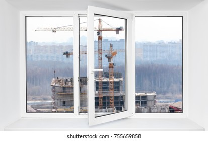 Loud construction site noise immission in opened one frame of white pvc window, view through