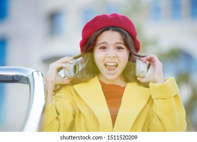 too loud. too high volume level. stresset about amount of information. audio book. listen to music. online education with ebook. e library. little girl shout with headphones. childhood development.