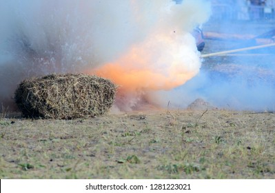 Loud massive explosion of bombs. Blast wave. Huge volumes of black smoke and sparks of fire. Detonation of bomb or cannon ball. Outburst close up. Smoke texture concept. Catastrophic case.