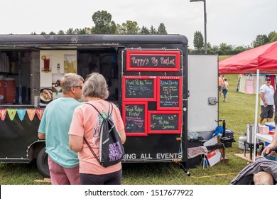 Loudon, TN / USA - SEPTEMBER 28 2019: FRIED PICKLE FESTIVAL Black BBQ Food truck selling fried pickle tacos and other menu items at the festival
