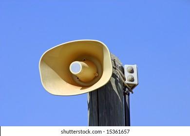 Loudspeaker on the wooden pole