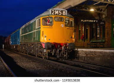 LOUGHBOROUGH, LEICESTERSHIRE, UK - FEBRUARY 25, 2015: Class 27 No. D5401and BR blue-liveried GUV Newspaper van at Loughborough Station, with a mail & newspaper loading, during an evening photo event.