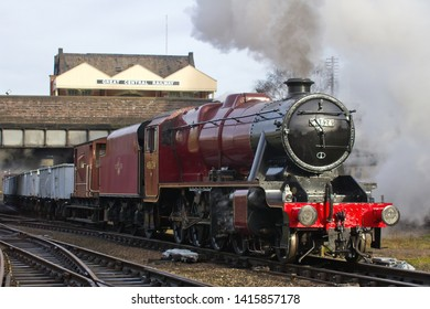LOUGHBOROUGH, LEICESTERSHIRE, UK - JANUARY 24, 2014: LMS Stanier 8F 2-8-0 No. 48624 pulls away from Loughborough with the 9C06 10:00 minerals train to Rothley Brook during the GCR's Winter Steam Gala.