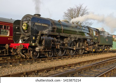 LOUGHBOROUGH, LEICESTERSHIRE, UK - JANUARY 24, 2014: A moment to reflect, as BR Britannia Class Pacific No. 70013 'Oliver Cromwell' carries a wreath, in memory of GCR Driver Mick Pickering.