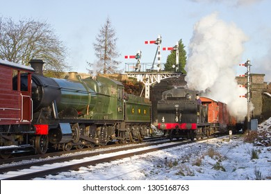 LOUGHBOROUGH, LEICESTERSHIRE, UK - JANUARY 26, 2013: Ex LMS Fowler Class 3F Jinty No. 47406 working the 7S04 freight train to Swithland passes a checked GWR Collett 2-8-0 No. 3803 on a minerals train.