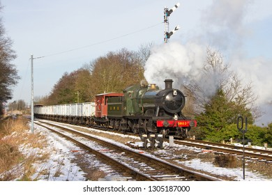LOUGHBOROUGH, LEICESTERSHIRE, UK - JANUARY 26, 2013: GWR Collett 2-8-0 No. 3803 approaches Quorn and Woodhouse during the GCR's Winter Steam Gala, working the 9C18 12:15 minerals train to Swithland.