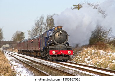 LOUGHBOROUGH, LEICESTERSHIRE, UK - JANUARY 26, 2013: A resplendent GWR 6000 Class 4-6-0 No. 6023 'King Edward II' powers through Woodthorpe for its next stop at Quorn and Woodhouse in the GCR's Gala.