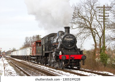 LOUGHBOROUGH, LEICESTERSHIRE, UK - JANUARY 26, 2013: LMS Ivatt Class 2 Mogul No. 46521 heads away from Quorn and Woodhouse during the GCR's Winter Steam Gala, with a train of mineral wagons.