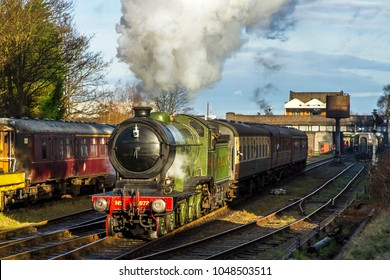 LOUGHBOROUGH, LEICESTERSHIRE, UK - JANUARY 28, 2018: Steam locomotive LNER B12 Class 4-6-0 No. 8572 hauls a passenger train out of Loughborough during the Great Central Railway's  Winter Steam Gala.