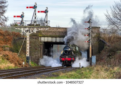 LOUGHBOROUGH, LEICESTERSHIRE, UK - JANUARY 28, 2018: Steam locomotive LMS Ivatt Class 2 2-6-0 No. 46521 repositions out of Loughborough during the Great Central Railway's  Winter Steam Gala.