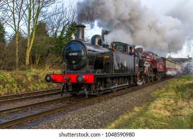 LOUGHBOROUGH, LEICESTERSHIRE, UK - JANUARY 28, 2018: Steam locomotive Ex LMS Fowler Class 3F Jinty No. 47406 hauls a passenger train out of Loughborough during the GCR's  Winter Steam Gala.