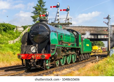 LOUGHBOROUGH, LEICESTERSHIRE, UK - JUNE 3, 2017: Steam locomotive SR King Arthur Class 4-6-0 No. 30777 'Sir Lamiel' repositions out of Loughborough during the GCR's  1940's Wartime Weekend.