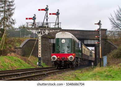 LOUGHBOROUGH, LEICESTERSHIRE, UK - JUNE 3, 2017: Diesel electric locomotive Class 20 No. D8098 hauls a passenger train out of Loughborough during the Great Central Railway's  Spring Diesel Gala.