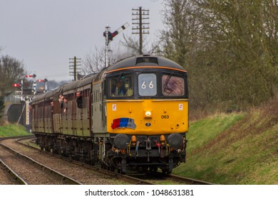 LOUGHBOROUGH, LEICESTERSHIRE, UK - MARCH 18, 2017: Diesel electric locomotive Class 33 No. 33063 'R.J. Mitchell' hauls a passenger train out of Loughborough during the GCR's  Spring Diesel Gala.