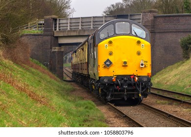 LOUGHBOROUGH, LEICESTERSHIRE, UK - MARCH 18, 2017: Diesel electric locomotive Class 37 No. 37714 'Cardiff Canton' heads into Loughborough with a passenger service during the GCR's  Spring Diesel Gala.