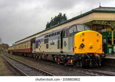 LOUGHBOROUGH, LEICESTERSHIRE, UK - MARCH 18, 2017: Diesel electric locomotive Class 37 No. 37714 'Cardiff Canton' stands at Loughborough with a passenger train during the GCR's  Spring Diesel Gala.