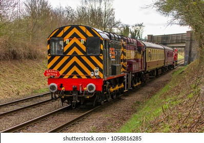 LOUGHBOROUGH, LEICESTERSHIRE, UK - MARCH 18, 2017: Railway Support Services (RSS) diesel electric Class 08 No. 08480 hauls a passenger train into Loughborough during the GCR's  Spring Diesel Gala.
