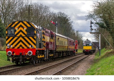 LOUGHBOROUGH, LEICESTERSHIRE, UK - MARCH 18, 2017: Railway Support Services (RSS) diesel electric Class 08 No. 08480 passes another train as it departs Loughborough during the GCR's Diesel Gala.