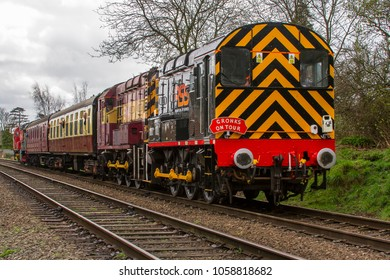 LOUGHBOROUGH, LEICESTERSHIRE, UK - MARCH 18, 2017: Railway Support Services (RSS) diesel electric Class 08 No. 08480 hauls a passenger train out of Loughborough during the GCR's  Spring Diesel Gala.