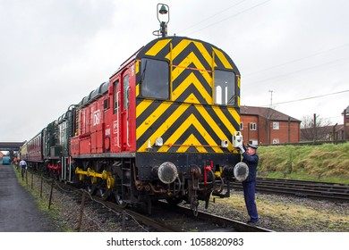 LOUGHBOROUGH, LEICESTERSHIRE, UK - MARCH 18, 2017: DB Schenker diesel electric Class 08 No. 08907 stands at Loughborough yard during the Great Central Railway's  Spring Diesel Gala.