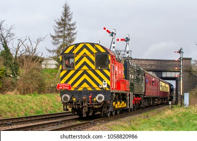 LOUGHBOROUGH, LEICESTERSHIRE, UK - MARCH 18, 2017: DB Schenker diesel electric Class 08 No. 08907 hauls a passenger train out of Loughborough during the Great Central Railway's  Spring Diesel Gala.