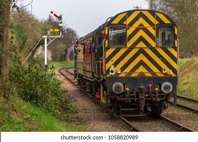 LOUGHBOROUGH, LEICESTERSHIRE, UK - MARCH 18, 2017: DB Schenker diesel electric Class 08 No. 08907 heads into Loughborough with a passenger train during the Great Central Railway's  Spring Diesel Gala.