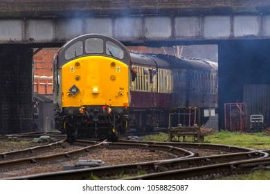 LOUGHBOROUGH, LEICESTERSHIRE, UK - MARCH 18, 2017: Diesel electric locomotive Class 37 No. 37714 'Cardiff Canton' heads out of Loughborough Station during the GCR's  Spring Diesel Gala.
