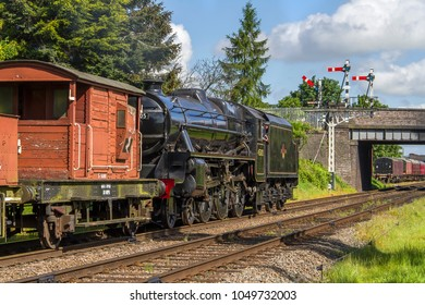 LOUGHBOROUGH, LEICESTERSHIRE, UK - MAY 22, 2016: Steam locomotive LMS Class 5MT 4-6-0 No. 45305 hauls a freight train into Loughborough during the GCR's  Railways at Work Gala.