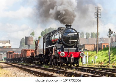 LOUGHBOROUGH, LEICESTERSHIRE, UK - MAY 22, 2016: Steam locomotive LMS Class 5MT 4-6-0 No. 45305 hauls a freight train out of Loughborough during the GCR's  Railways at Work Gala.