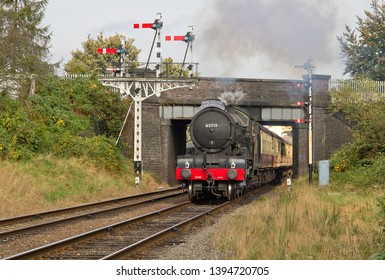 LOUGHBOROUGH, LEICESTERSHIRE, UK - OCTOBER 3, 2014: LNER Class D49 4-4-0 No. 62712 'Morayshire', carrying 'The South Yorkshire' headboard, races through the Beeches Road Bridge at Loughborough.