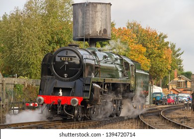 LOUGHBOROUGH, LEICESTERSHIRE, UK - OCTOBER 3, 2014: A resplendent BR Standard 9F 2-10-0 No. 92214 manoeuvres through Loughborough Yard on the second day of the GCR's Autumn Steam Gala.