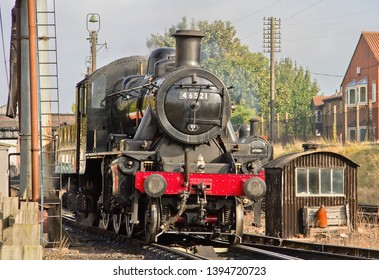 LOUGHBOROUGH, LEICESTERSHIRE, UK - OCTOBER 3, 2014: Ivatt Class 2MT Mogul No. 46521 heads to the water tower in Loughborough yard at the start of the GCR's Autumn Steam Gala.