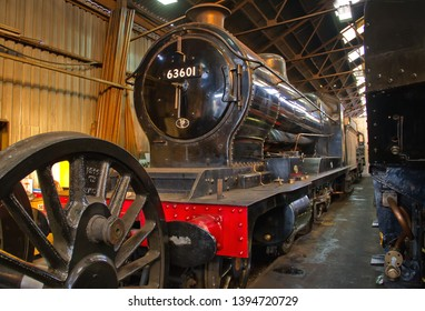 LOUGHBOROUGH, LEICESTERSHIRE, UK - OCTOBER 3, 2014:  GCR Class 8K 2-8-0 No. 63601, a class of steam locomotive designed for heavy freight in the early 1900s, stands in the shed at Loughborough.