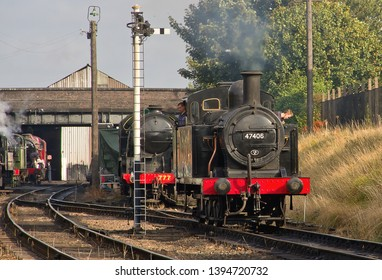 LOUGHBOROUGH, LEICESTERSHIRE, UK - OCTOBER 3, 2014: Ex LMS Fowler Class 3F Jinty No. 47406 eases out of a busy Loughborough yard at the start of the GCR's Autumn Steam Gala.