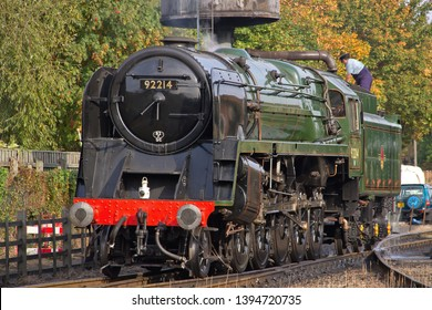LOUGHBOROUGH, LEICESTERSHIRE, UK - OCTOBER 3, 2014: At the start of the GCR's Autumn Steam Gala, BR Standard 9F 2-10-0 No. 92214 takes on water at Loughborough Yard, prior to working a freight train.