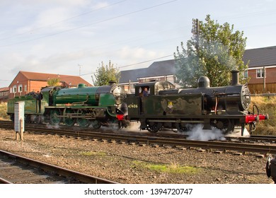 LOUGHBOROUGH, LEICESTERSHIRE, UK - OCTOBER 3, 2014: Ex LMS Fowler Class 3F Jinty No. 47406 pulls SR King Arthur 4-6-0 No. 30777 'Sir Lamiel' through Loughborough Yard during GCR's Autumn Steam Gala.