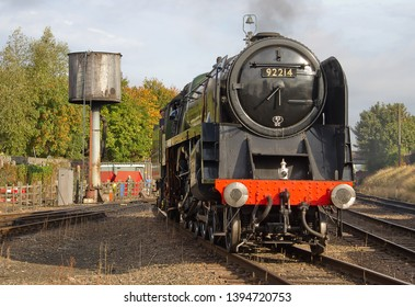 LOUGHBOROUGH, LEICESTERSHIRE, UK - OCTOBER 3, 2014: BR Standard 9F 2-10-0 No. 92214 moves through Loughborough Yard during the second day of the GCR's Autumn Steam Gala.