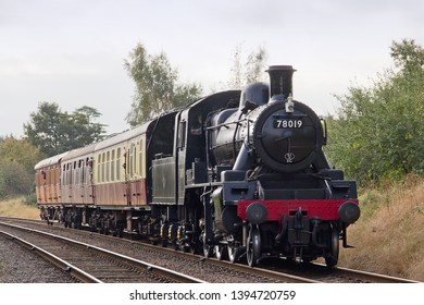 LOUGHBOROUGH, LEICESTERSHIRE, UK - OCTOBER 3, 2014: LMS Ivatt Class 2 Mogul No. 78019 approaches Loughborough's Beeches Road Bridge, as it works the 2D05 10:45 service out of Rothley.
