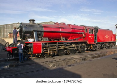 LOUGHBOROUGH, LEICESTERSHIRE, UK - OCTOBER 3, 2014: LMS Stanier 8F 2-8-0 No. 48624 is prepared for duty at the start of the second day of the GCR's four-day Autumn Steam Gala.