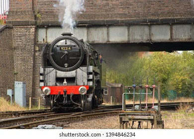 LOUGHBOROUGH, LEICESTERSHIRE, UK - OCTOBER 3, 2014: BR Standard 9F 2-10-0 No. 92214 carries out a positioning move at Loughborough during the GCR's Autumn Steam Gala.