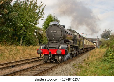 LOUGHBOROUGH, LEICESTERSHIRE, UK - OCTOBER 3, 2014: LNER Class D49 4-4-0 No. 62712 'Morayshire', carrying 'The South Yorkshire' headboard, heads south away from Loughborough.