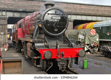LOUGHBOROUGH, LEICESTERSHIRE, UK - OCTOBER 3, 2014: LMS Stanier 8F 2-8-0 No. 48624 stands in Loughborough yard at the end of the day during the GCR's Autumn Steam Gala.