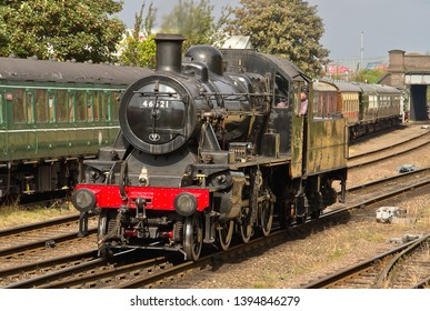 LOUGHBOROUGH, LEICESTERSHIRE, UK - OCTOBER 3, 2014: Ivatt Class 2MT Mogul No. 46521 carries out a positioning move on the second day of the GCR's 4 day Autumn Steam Gala, seen here at Loughborough.