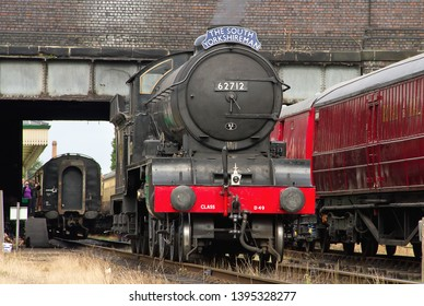 LOUGHBOROUGH, LEICESTERSHIRE, UK - OCTOBER 3, 2014: LNER Class D49 4-4-0 No. 62712 'Morayshire', as The South Yorkshireman, backs up to its train at Loughborough Station during the GCR's Steam Gala.