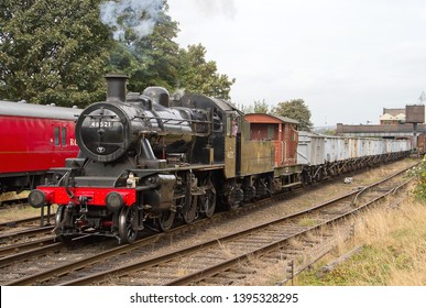 LOUGHBOROUGH, LEICESTERSHIRE, UK - OCTOBER 3, 2014: Ivatt Class 2MT Mogul No. 46521 works the 7C20 12:25 minerals train out of Loughborough, hauling a train of 'Windcutters' to Rothley Brook.
