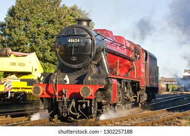 LOUGHBOROUGH, LEICESTERSHIRE, UK - OCTOBER 6, 2012: LMS Stanier 8F 2-8-0 No. 48624 runs light engine through Loughborough yard, seen here on a positioning move at the GCR during the Autumn Gala.