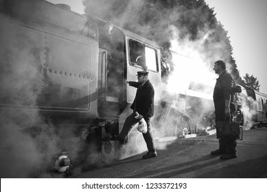 LOUGHBOROUGH, UK - 18 NOV 1018: Train crew board a vintage steam engine at the Great Central Railway