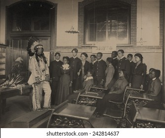 Louis Firetail, wearing Sioux tribal clothing, in an American history class at Hampton Institute. Founded as an African American college during the Civil War. Ca. 1900.