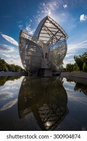 Louis Vuitton Foundation PARIS, FRANCE - June 18, 2015: building. Made of 3,584 laminated glass panels, it was designed by the architect Frank Gehry and opened to the public in 2014.
