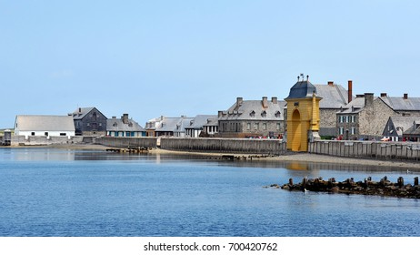LOUISBOURG, CANADA - JUL 30, 2016:  Period buildings at the Fortress of Louisbourg, which was restored to resemble how the French colony looked in the 1700s.